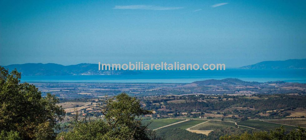 Italian coastal property for sale. Tuscany farmhouse with sea views. Restored 3 bed property with large garden, around 2.5 hectares of land in the Tuscan Maremma.