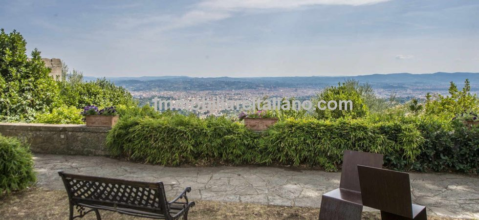 Florence Tuscany luxury accommodation business for sale. 14.4 ha estate, 28 bedrooms, heli pad, swimming pool, olive grove. Superb views over Florence.