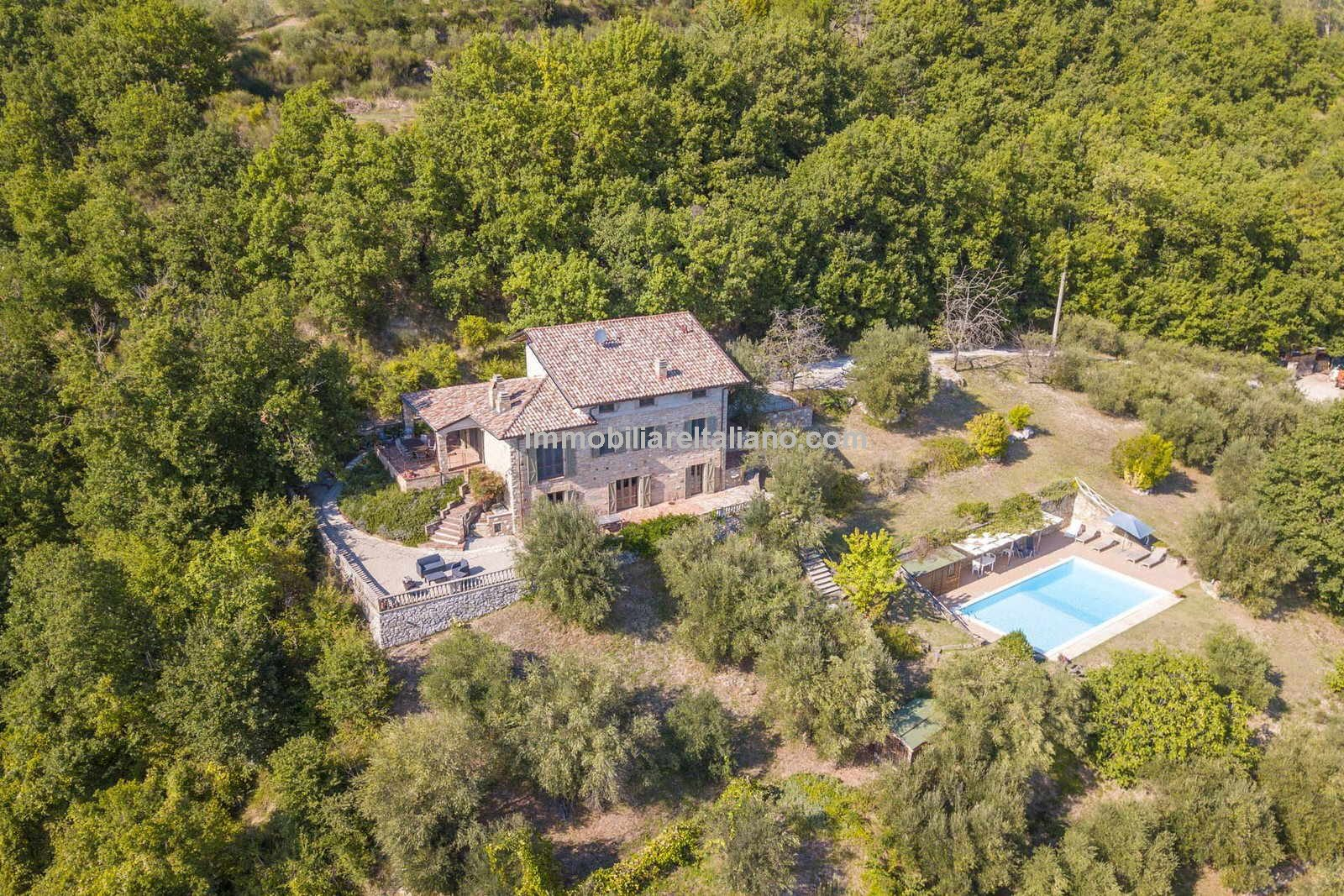 Aerial view of Italian farmhouse with pool