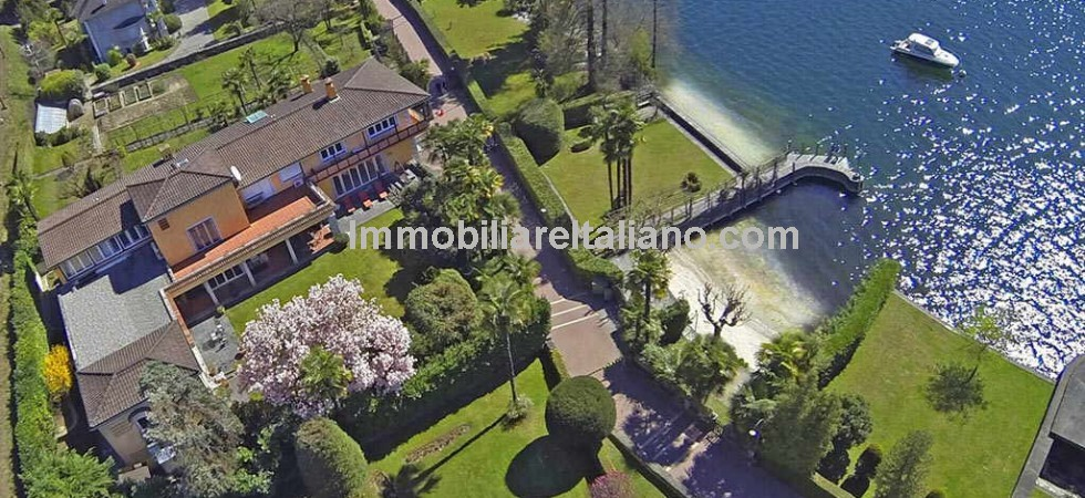 Luxury Swiss villa property for sale, Locarno on Lake Maggiore with private beach and dock. Rolls Royce Phantom and boat included. Indoor pool, three independent staff apartments, perfectly maintained garden, private beach and jetty dock.