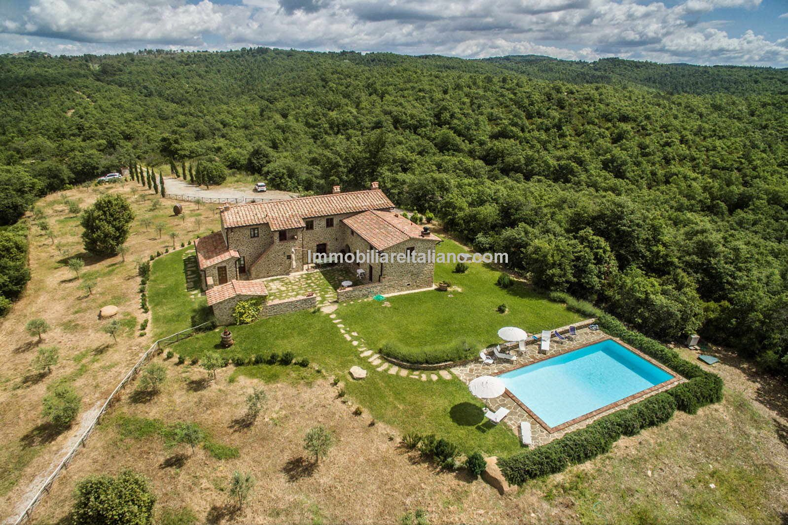 Farmhouse in Tuscany with courtyard, pool, woodland and olive grove