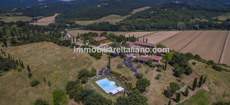 For sale near to the Umbria Tuscany border luxury stone farmhouse with outbuilding with garage, pool house, swimming pool and bocce court.