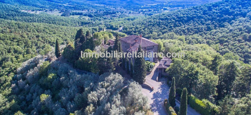 Located near to Castiglion Fiorentino is this 18th century Tuscan hamlet estate with pool, consecrated church, rectory and land for sale. A lot of property at an astonishingly low price.
