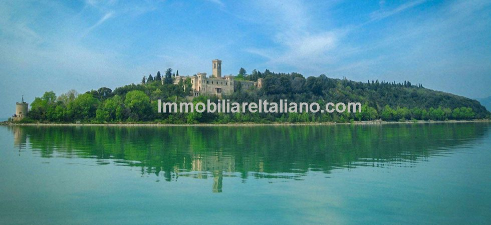 19th Century castle for sale - Isola Maggiore Lake Trasimeno. Exciting opportunity to buy a castle in a magical position on a lake and accessible only by boat. Plan approved for hotel and yacht club activity.