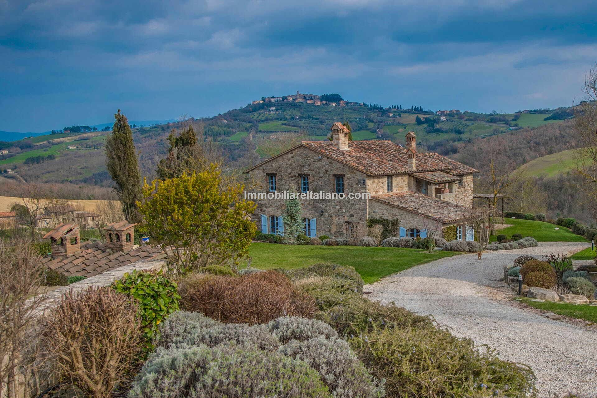 Umbria Italy property comprising a pair of farmhouses. Fully restored farmhouses with garden, swimming pool and wellness centre