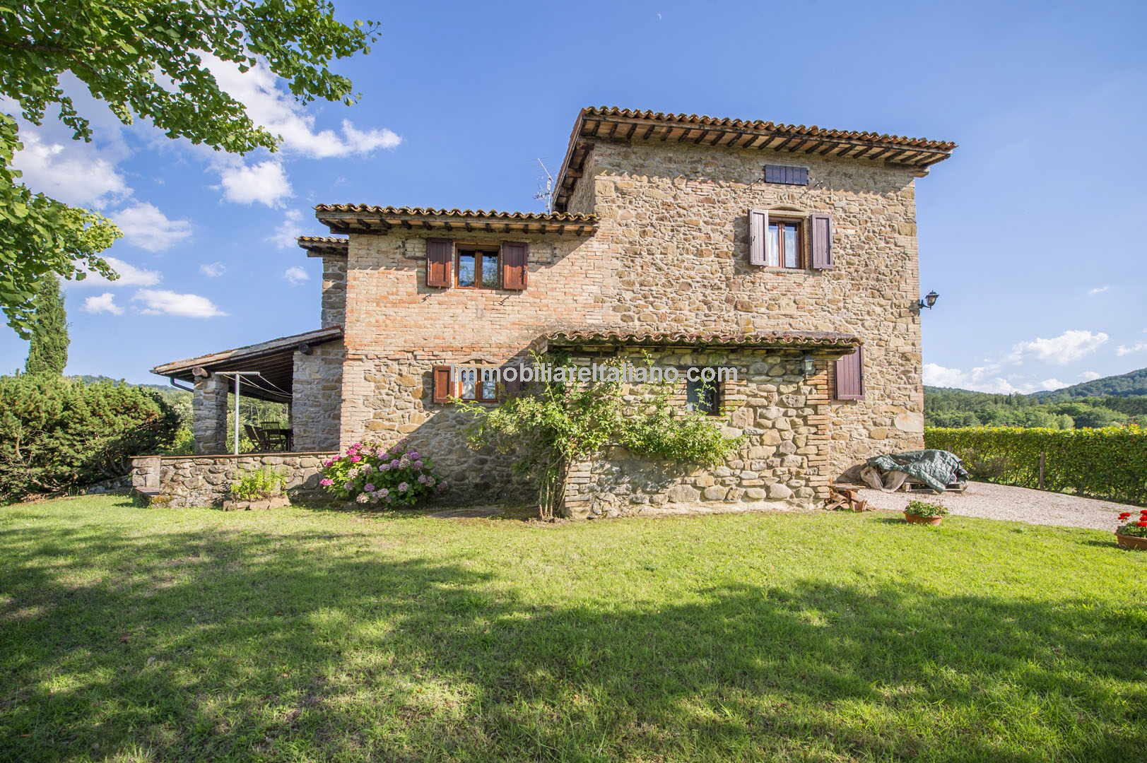 restored stone farmhouse in Italy with pool and 5,000 sqm garden.