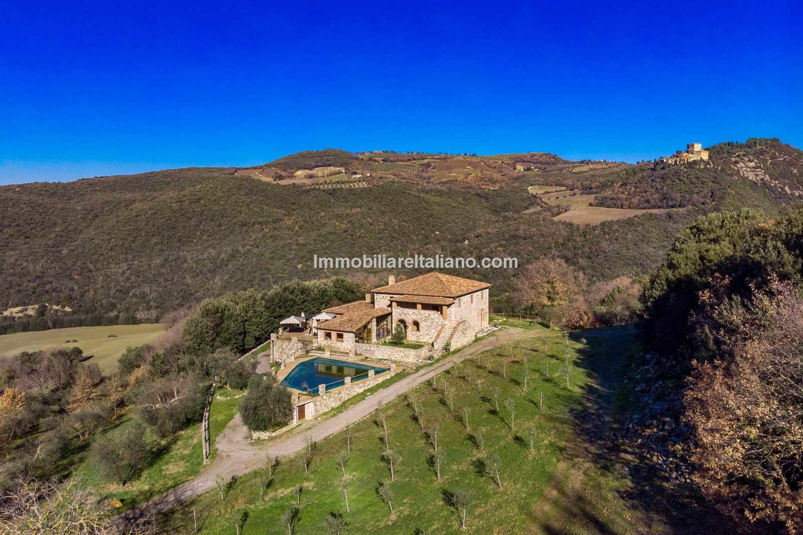 Aerial view of large Tuscan villa for sale